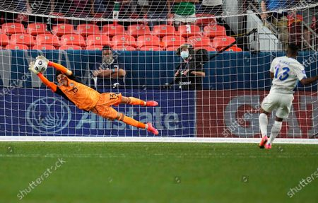 Mexico's Guillermo Ochoa makes a save against Costa Rica's Allan Cruz (13) to win on penalty kicks during a CONCACAF Nations League soccer semifinal, in Denver