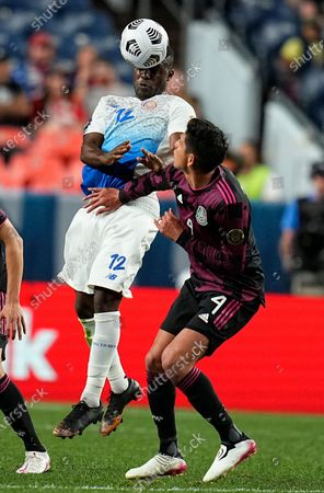 Costa Rica's Joel Campbell (12) heads the ball next to Mexico's Edson Álvarez (4) during the second half of a CONCACAF Nations League soccer semifinal, in Denver