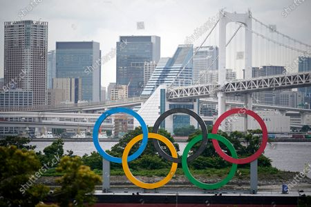 A giant Olympic rings monument is seen at Odaiba Marine Park in Tokyo, Japan, 03 June 2021 (issued 04 June 2021). Tamayo Marukawa, the minister in charge of the Tokyo Olympics, announced on 04 June that a reception for overseas officials planned to be hosted by Prime Minister Yoshihide Suga on 08 August 2021, the last day of the Tokyo Olympics, has been canceled to avoid spread of COVID-19 cases.