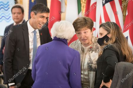 Britain's Chancellor of the Exchequer Rishi Sunak, left, U.S. Treasury Secretary Janet Yellen, back to camera, and Canadian Finance Minister Chrystia Freeland, right, talk during a meeting of finance ministers from across the G7 nations at Lancaster House in London
