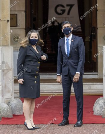 Britain's Chancellor of the Exchequer Rishi Sunak, right, welcomes Canada's Finance Minister Chrystia Freeland, ahead of the G7 finance ministers meeting at Lancaster House in London