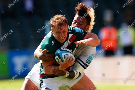 Tommy Reffell of Leicester Tigers is stopped by Nathan Hughes of Bristol Bears; Mattioli Woods Welford Road Stadium, Leicester, Midlands, England; Gallagher Premiership Rugby, Leicester Tigers versus Bristol Bears.
