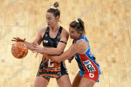 Jamie-Lee Price of Giants Netball catches the ball under pressure from Maddy Proud of NSW Swifts; Ken Rosewall Arena, Sydney, New South Wales, Australia; Australian Suncorp Super Netball, New South Wales, NSW Swifts versus Giants Netball.
