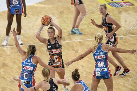 Jamie-Lee Price of Giants Netball looks for pass options as Maddy Proud of NSW Swifts attempts to block the pass; Ken Rosewall Arena, Sydney, New South Wales, Australia; Australian Suncorp Super Netball, New South Wales, NSW Swifts versus Giants Netball.