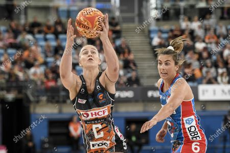 Jamie-Lee Price of the Giants Netball catches the ball under pressure from Maddy Proud of NSW Swifts; Ken Rosewall Arena, Sydney, New South Wales, Australia; Australian Suncorp Super Netball, New South Wales, NSW Swifts versus Giants Netball.