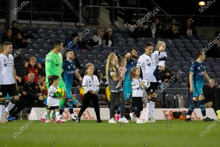 Mark Milligan of Macarthur FC enters the field with his daughters