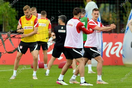 Polish national soccer team players Michal Helik (L), Grzegorz Krychowiak (C) and Arkadiusz Milik (R) during a training session in Opalenica, Poland, 04 June 2021. Poland is preparing for the UEFA EURO 2020 tournament and will face Spain, Sweden and Slovakia in their Group E stage.