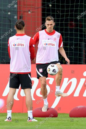 Polish national soccer team player Arkadiusz Milik (R) during a training session in Opalenica, Poland, 04 June 2021. Poland is preparing for the UEFA EURO 2020 tournament and will face Spain, Sweden and Slovakia in their Group E stage.