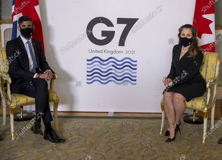 Britain's Chancellor of the Exchequer Rishi Sunak, left, poses for a photo with Canada's Finance Minister Chrystia Freeland, prior to a meeting of G7 Finance Ministers, ahead of the G7 leaders' summit, at Lancaster House in London