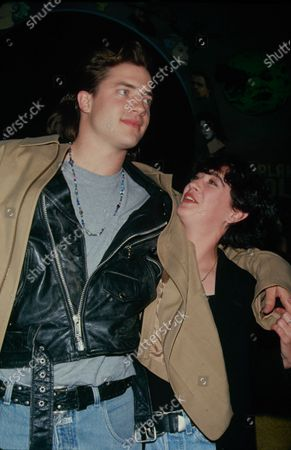 UNITED STATES - circa 1994: Actors Moira Kelly and Brendan Fraser at Planet Hollywood, publicising their film 'With Honors'.