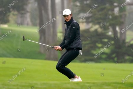 Michelle Wie West reacts as she misses her putt on the ninth green during the second round of the U.S. Women's Open golf tournament at The Olympic Club, in San Francisco