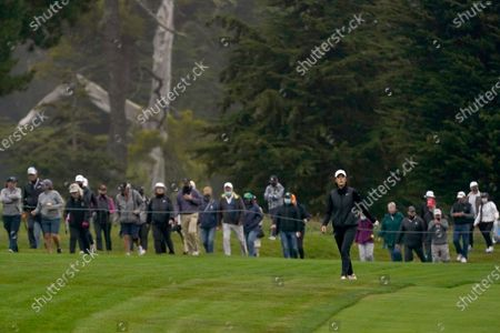 The gallery follows Michelle Wie West up the 14th fairway during the second round of the U.S. Women's Open golf tournament at The Olympic Club, in San Francisco