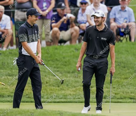 Jordan Spieth of the US (L) and Patrick Cantlay of the US (R) laugh while preparing to putt on the eleventh green during the second round of The Memorial golf tournament at Muirfield Village Golf Club in Dublin, Ohio, USA, 04 June 2021. The Memorial tournament will be played 03 June through 06 June.