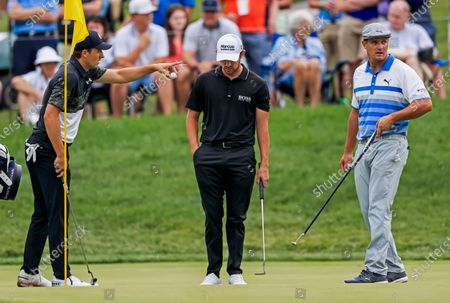 Jordan Spieth of the US (L) Patrick Cantlay of the US (C) and Bryson DeChambeau of the US (R) stand on the eleventh green during the second round of The Memorial golf tournament at Muirfield Village Golf Club in Dublin, Ohio, USA, 04 June 2021. The Memorial tournament will be played 03 June through 06 June.