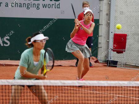 (210604) - PARIS, June 4, 2021 (Xinhua) - Zhang Shuai (R) and Xu Yifan of China compete during the women's doubles second round match between Zhang Shuai/Xu Yifan of China and Karolina Pliskova/Kristyna Pliskova of the Czech Republic at the French Open tennis tournament in Paris, France, June 4, 2021.