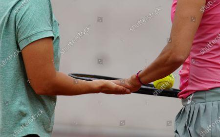 (210604) - PARIS, June 4, 2021 (Xinhua) - Zhang Shuai (R) and Xu Yifan of China react during the women's doubles second round match between Zhang Shuai/Xu Yifan of China and Karolina Pliskova/Kristyna Pliskova of the Czech Republic at the French Open tennis tournament in Paris, France, June 4, 2021.