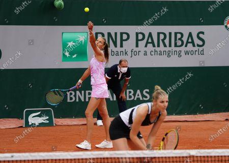 (210604) - PARIS, June 4, 2021 (Xinhua) - Karolina Pliskova (L) and Kristyna Pliskova compete during the women's doubles second round match between Zhang Shuai/Xu Yifan of China and Karolina Pliskova/Kristyna Pliskova of the Czech Republic at the French Open tennis tournament in Paris, France, Jr A 4, 2021.