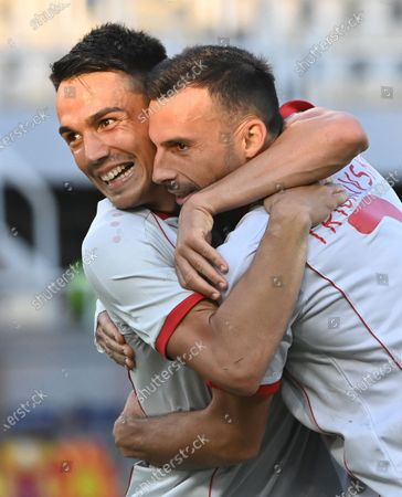 Stock Image of North Macedonia's Ivan Trickovski celebrates celebrates with Tihomir Kostadinov (L) after scoring the 2-0 goal during the international friendly soccer match between North Macedonia and Kazakhstan in Skopje, Republic of North Macedonia, 04 June 2021.