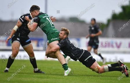 Peter Sullivan of Connacht is tackled by Will Griffiths of Ospreys
