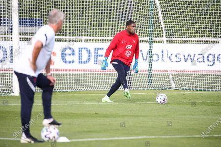 "French national soccer team ""Les Bleus"" head coach Didier Deschamps observes his goalkeeper Mike Maignan"