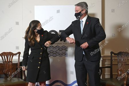 Canada's Finance Minister Chrystia Freeland, left, and Secretary-General of the Organisation for Economic Co-operation and Development (OECD) Mathias Cormann greet each other during their meeting, as finance ministers from across the G7 nations meet at Lancaster House in London, ahead of the G7 leaders' summit