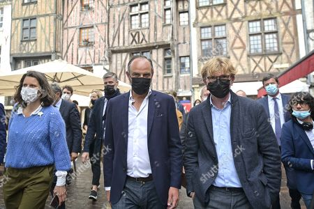 Former French Prime Minister Edouard Philippe (C) walks to an old street with the French Junior Minister of Parliament Marc Fesneau (R), candidate at the regional election