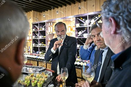 Stock Image of Former French Prime Minister Edouard Philippe (C) drinks a glass of wine as he supports the French Junior Minister of Parliament Marc Fesneau (not visible) at the regional election