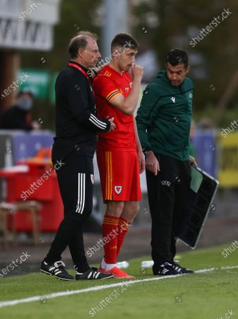 Wales U21 coach Paul Bodin with Lewis Collins of Wales as he comes on a substitute