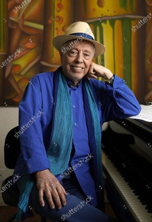 """Brazilian musician Sergio Mendes poses for a portrait at home, in Los Angeles. The documentary """"Sergio Mendes & Friends: A Celebration"""" will be airing on PBS in June"""
