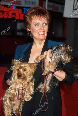 Actress Maureen McGovern holding her two terriers at Paw Print Wall of Fame.