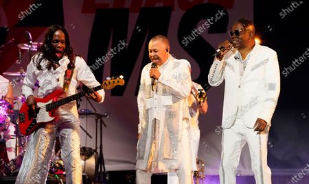 From left, Verdin White, Ralph Johnson and Philip Bailey of Earth, Wind & Fire perform at the Race to Erase MS drive-in event at the Rose Bowl, in Pasadena, Calif