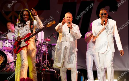 From left, Verdine White, Ralph Johnson and Philip Bailey of Earth, Wind & Fire perform at the Race to Erase MS drive-in event at the Rose Bowl, in Pasadena, Calif
