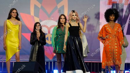Fashion designer Stacey Bendet, second from right, poses with models at the close of a fashion show at the Race to Erase MS drive-in event at the Rose Bowl, in Pasadena, Calif