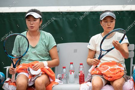 Stock Photo of (210605) - PARIS, June 5, 2021 (Xinhua) - Yang Zhaoxuan (L) of China and Makoto Ninomiya of Japan are seen during the women's doubles second round match between Yang Zhaoxuan of China/Makoto Ninomiya of Japan and Petra Martic of Croatia/Shelby Rogers of the United States at the French Open tennis tournament at Roland Garros in Paris, France, June 4, 2021.