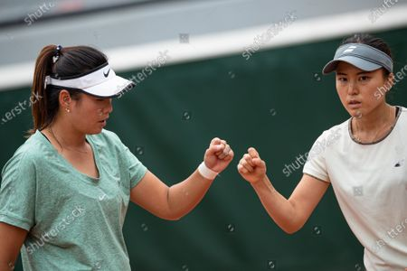 Stock Image of (210605) - PARIS, June 5, 2021 (Xinhua) - Yang Zhaoxuan (L) of China and Makoto Ninomiya of Japan react during the women's doubles second round match between Yang Zhaoxuan of China/Makoto Ninomiya of Japan and Petra Martic of Croatia/Shelby Rogers of the United States at the French Open tennis tournament at Roland Garros in Paris, France, June 4, 2021.