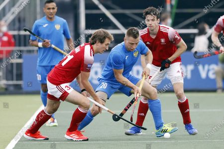 Will Calnan (L) of England and Artem Nadyrshin of Russia in action during the EuroHockey Championships 2021 Men Pool A match between England and Russia at Wagener Stadium in Amstelveen, The Netherlands, 05 June 2021.