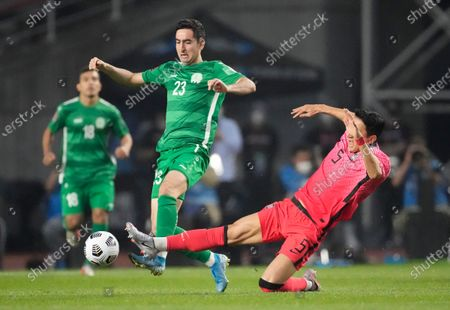 South Korea's Jung Woo-young, right, fights for the ball against Turkmenistan's Velmyrat Ballakov during their Asian zone Group H qualifying soccer match for the FIFA World Cup Qatar 2022 at Goyang stadium in Goyang, South Korea