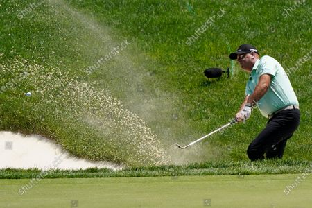 Stewart Cink hits out of a bunker to the 14th green during the third round of the Memorial golf tournament, in Dublin, Ohio