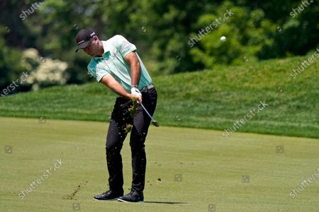 Stewart Cink hits to the 13th green during the third round of the Memorial golf tournament, in Dublin, Ohio