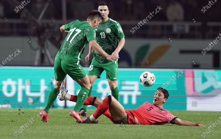 Stock Picture of Jung Woo-young of South Korea makes a sliding tackle to win the ball from Altymyrat Annadurdiyev of Turkmenistan during 2022 FIFA World Cup Asia qualification Round 2 Group H match between South Korea and Turkmenistan at the Goyang Stadium in Goyang, South Korea, 05 June 2021.