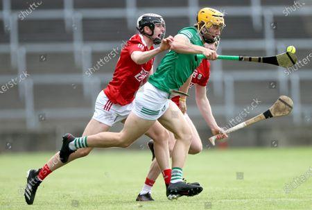 Limerick vs Cork. Cork's Ger Millerick and Jack O' Connor tackle Tom Morrissey of Limerick