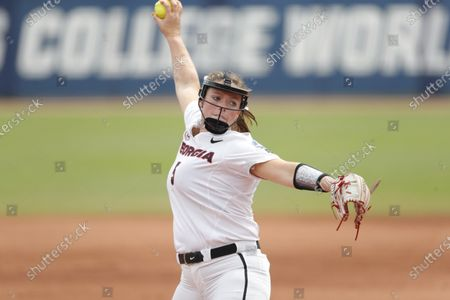 Georgia starting pitcher Mary Wilson Avant (5) delivers a pitch to Oklahoma in the first inning of an NCAA Women's College World Series softball game against Georgia, in Oklahoma City