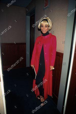 Actress Mel Gorham, wearing blonde wig.