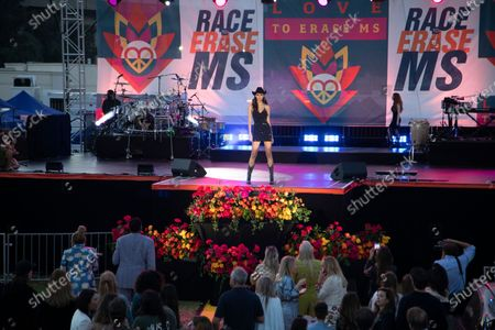 """An alice + olivia spring/summer 2021 fashion show by designer Stacey Bendet is among the evening's entertainment during the """"Race to Erase MS"""" benefit at the Rose Bowl on Friday, June 4, 2021 in Pasadena, CA. Earth, Wind & Fire was the musical headliner. (Myung J. Chun / Los Angeles Times)"""