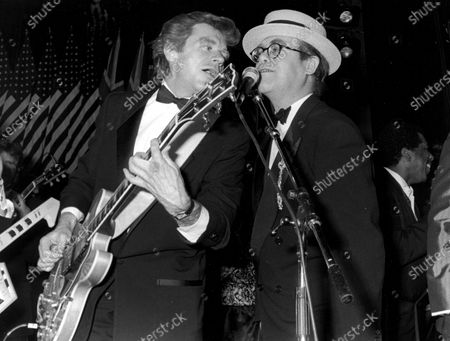 (L-R) Singers Dave Edmunds & Elton John performing at the Rock & Roll Hall of Fame.