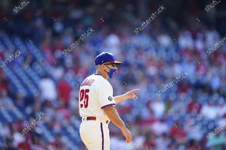 Philadelphia Phillies' Joe Girardi manages during a baseball game against the Washington Nationals, in Philadelphia