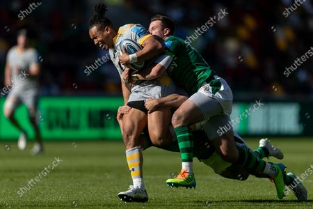 Marcus Watson of Wasps is tackled by Tom Parton and Nic Groom of London Irish during the Gallagher Premiership match between London Irish and Wasps at the Brentford Community Stadium, Brentford on Saturday 5th June 2021.