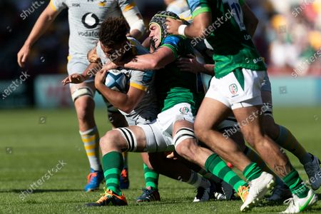 Marcus Watson of Wasps is tackled by Rob Simmons of London Irish during the Gallagher Premiership match between London Irish and Wasps at the Brentford Community Stadium, Brentford on Saturday 5th June 2021.