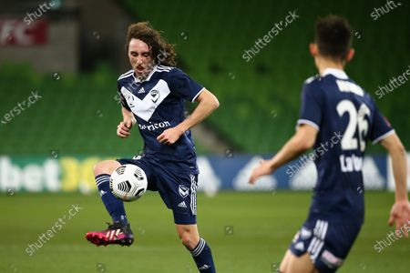 Jay Barnett of Melbourne Victory kicks the ball.