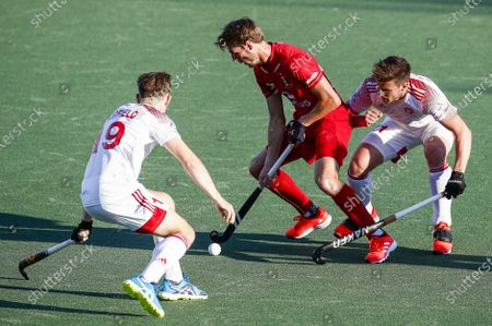Antoine Kina (C) of Belgium in action against English players David Goodfield (L) and Liam Ansell (R) during the European Hockey Championship men pool A match between England and Belgium at the Wagener Stadium in Amstelveen, Netherlands, 06 June 2021.